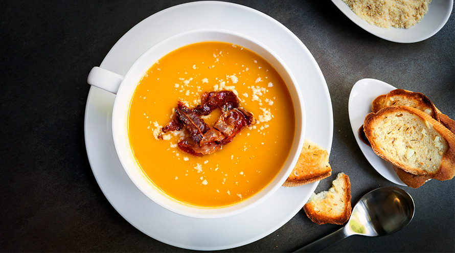 Butternut squash soup with maple bacon and a hint of Parmesan cheese